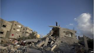 Palestinian at a destroyed building following an Israeli military strike on Beit Lahya on 15 July.