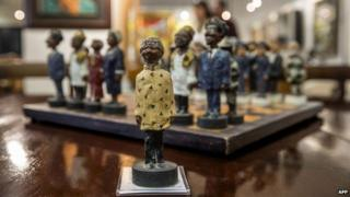 A chessboard, showing South Africa's politicians, including late President Nelson Mandela (C) as the the king figurine