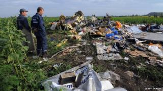 Employees of the Ukrainian State Emergency Service at wreckage of Malaysia Airlines flight MH17