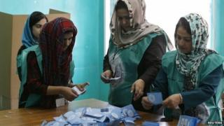Afghan election officials count ballots