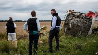 Alexander Hug, centre, deputy head of the OSCE mission, stands at the crash site
