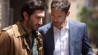 Fares Fares and Adam Rayner in an episode of Tyrant