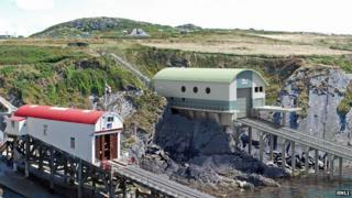 Artist's impression of new RNLI station (in green) alongside the existing boathouse and slipway (in red)