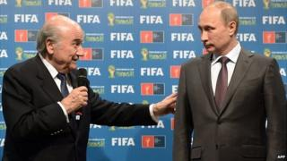 Fifa president Sepp Blatter (L) and Russia's President Vladimir Putin during a handover ceremony for the 2018 World Cup in Rio de Janeiro on 13 July, 2014