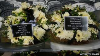 Wreaths in memory of John Alder and Liam Sweeney placed on seats