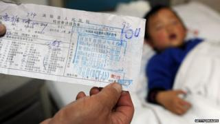 A photo of a form in Chinese with the positive results of a child's hepatitis C test