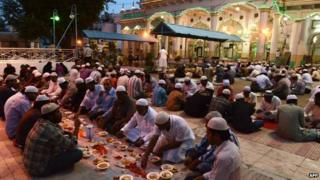 Indian Muslims break their fast during the holy month of Ramadan in Hyderabad on July 18, 2014.