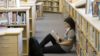 Girl reading in a library
