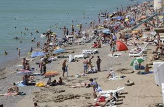 Holidaymakers on a beach in Crimea, 29 June 2014