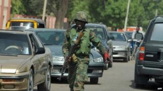 An officer pictured amidst the traffic of Maiduguri, Nigeria - April 2013