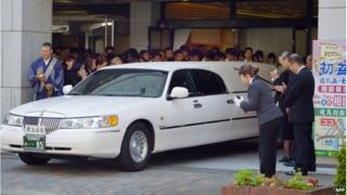 The hearse carrying the coffin of Japanese schoolgirl Aiwa Matsuo, alleged to have been murdered by a classmate, leaves the funeral hall in Sasebo, western Japan, on 29 July 2014.