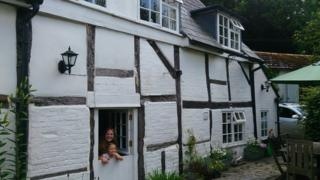 Rebecca Fletcher and her daughter at their new home in Hampshire