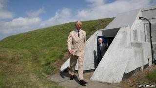 The Prince of Wales emerges from a bunker