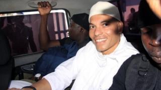 Karim Wade arrives in court in Dakar, Senegal, on 31 July 2014