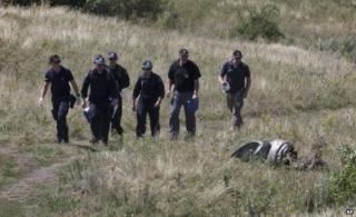 Australian experts examine the area of the Malaysia Airlines Flight 17 plane crash near the village of Grabove, east Ukraine, 1 August
