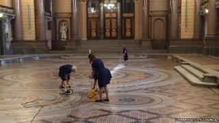 Cleaners washing the Minton tiles