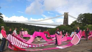 A 100m (328 ft) long pink scarf unveiled in Bristol
