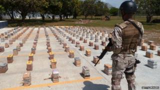 A drugs haul guarded by a Panamanian soldier