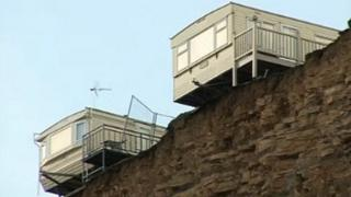 Caravans on edge of cliff