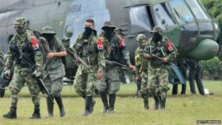Demobilised members of the ELN (National Liberation Army) arrive in Cali, Colombia on 16 July, 2013.