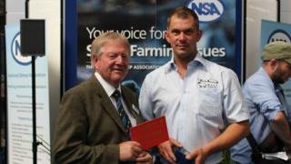 Isle of Man farmer Will Quilliam collecting the film award from the National Sheep Association
