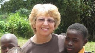 photo provided by Jeremy Writebol show his mother, Nancy Writebol, with children in Liberia 7 October 2013