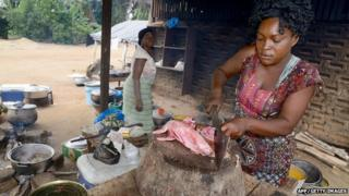 Woman preparing meat