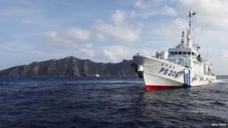 Japan Coast Guard vessel PS206 Houou sails in front of Uotsuri island, one of the disputed islands, called Senkaku in Japan and Diaoyu in China, in the East China Sea, in this 18 August 2013 file photo
