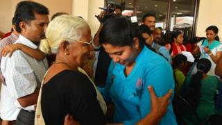 Nurses returning from Libya at the Kochi airport