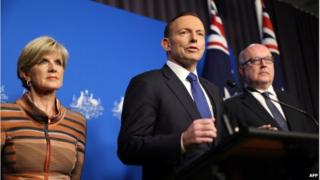 This picture released by the Australia Prime Minister Office on 5 August 2014 shows Prime Minister Tony Abbott (centre) speaking at a joint press conference with Foreign Minister Julie Bishop and Attorney General George Brandis (right) in Canberra