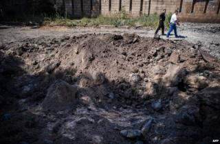 A crater left by a reported air strike on Donetsk, 6 August