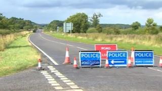 Road closed at crash scene