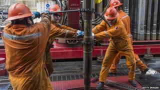 Derrick hands on a Pemex owned oil rig