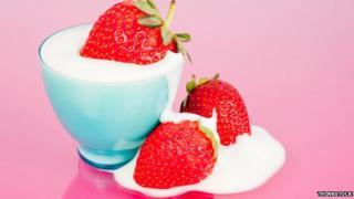Cream poured over strawberries