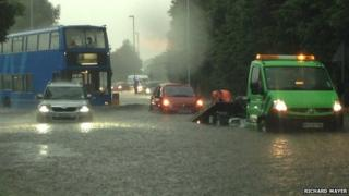 Cars trapped in flooding near the Bar Hill roundabout