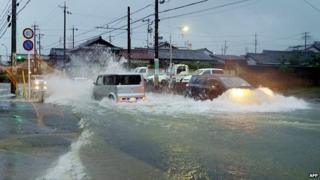 Flooded road in the city of Tsu, Mie prefecture. 9 Aug 2014