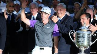 Rory McIlroy posing with trophy