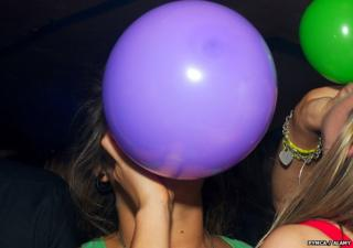 A women with a laughing gas balloon