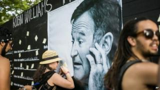 Festival goers pay tribute to the late actor Robin Williams at the 22nd Sziget (Island) Festival on the Shipyard Island in Northern Budapest, Hungary 13 August 2014