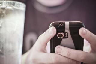 Boy texting on phone