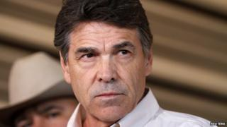 Texas Governor Rick Perry answers questions from the media after taking an aerial tour over the fertilizer plant explosion site in West, Texas in this 19 April 2013 file photo.