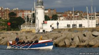 People rowing a lifeboat along North Yorkshire coast
