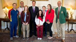 Team Isle of Man Team Captain and gymnast Alex Hedges, left, at 10 Downing Street with Prime Minister David Cameron. Left to right the other team representatives are Nick Mace (Guernsey – rifle shooting); Charlotte Pollard (Jersey – artistic gymnastics); Claudia Fragapane (England – gymnastics); Louise Renicks (Scotland – judo); Francesca Jones (Wales – rhythmic gymnastics); and David Calvert (Northern Ireland – rifle shooting).