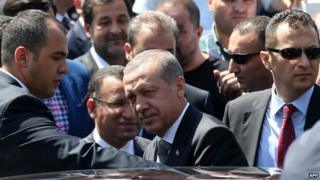 Mr Erdogan getting into his car after Friday prayers, 15 Aug 2014.