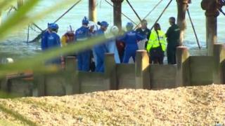 Emergency services on Eastbourne bach after man fell from pier