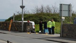 Guernsey Police officers examining crash site at Salerie Corner