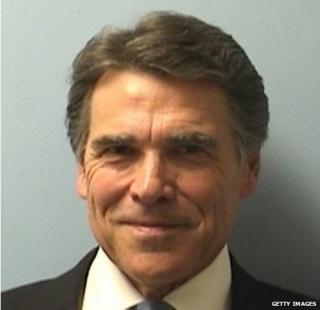 In this handout provided by the Travis County Sheriffs Office, Texas Gov. Rick Perry poses for a mug shot photo after turning himself in to authorities in Austin, Texas 19 August 2014