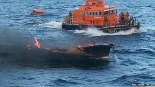 Burning yacht