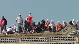 Rioters on roof of prison with hostages - 24 August