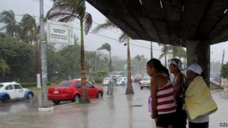 Residents shelter from heavy rain brought by hurricane Marie, in Puerto Vallarta, Jalisco state on 24 August 2014